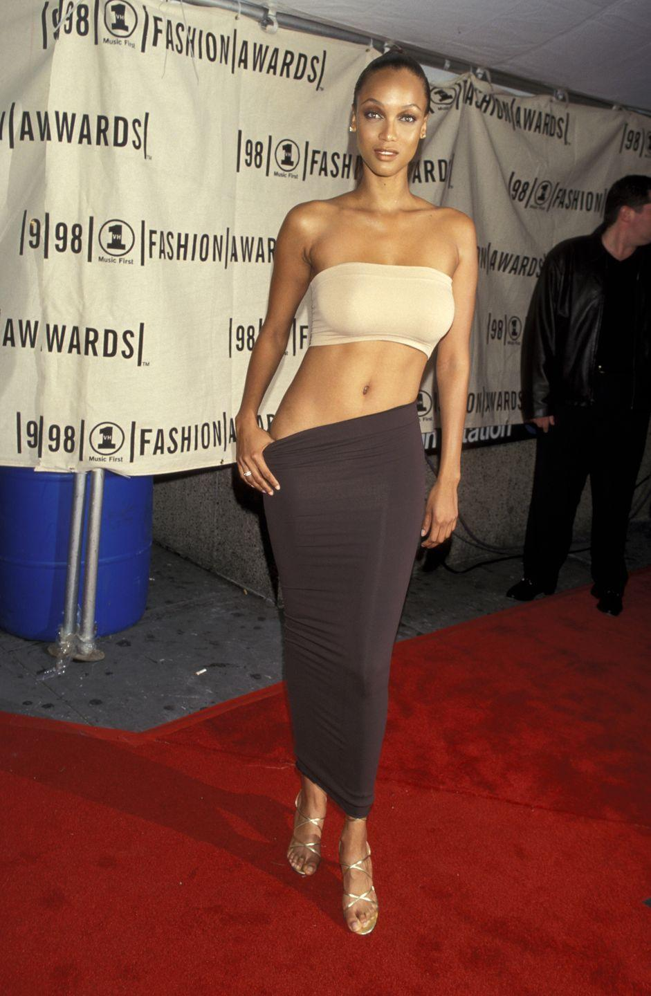 <p>Tyra showed up to the VH1 Fashion Awards (which I don't think even exists anymore?) in metallic sandals, a neutral bandeau, and a brown figure-hugging jersey skirt. <em>Fifty Shades of Grey</em>? More like Two Shades of Beige. </p>