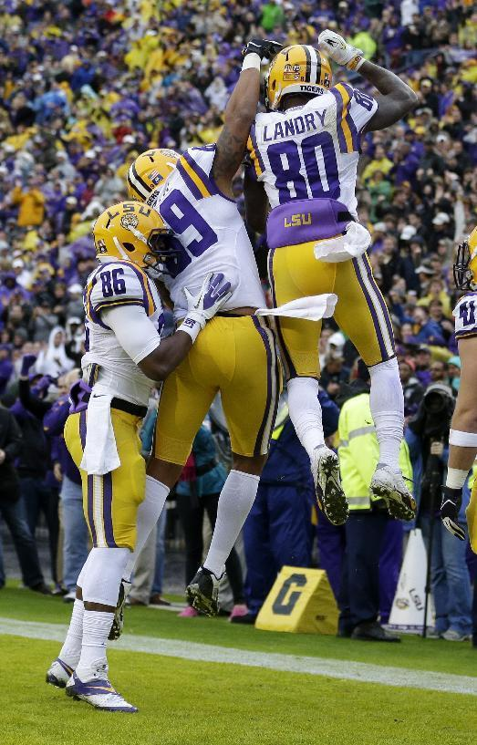 LSU wide receiver Jarvis Landry (80) celebrates his touchdown reception with wide receiver Kadron Boone (86) and tight end DeSean Smith in the first half of an NCAA college football game against Texas A&M in Baton Rouge, La., Saturday, Nov. 23, 2013. (AP Photo/Gerald Herbert)