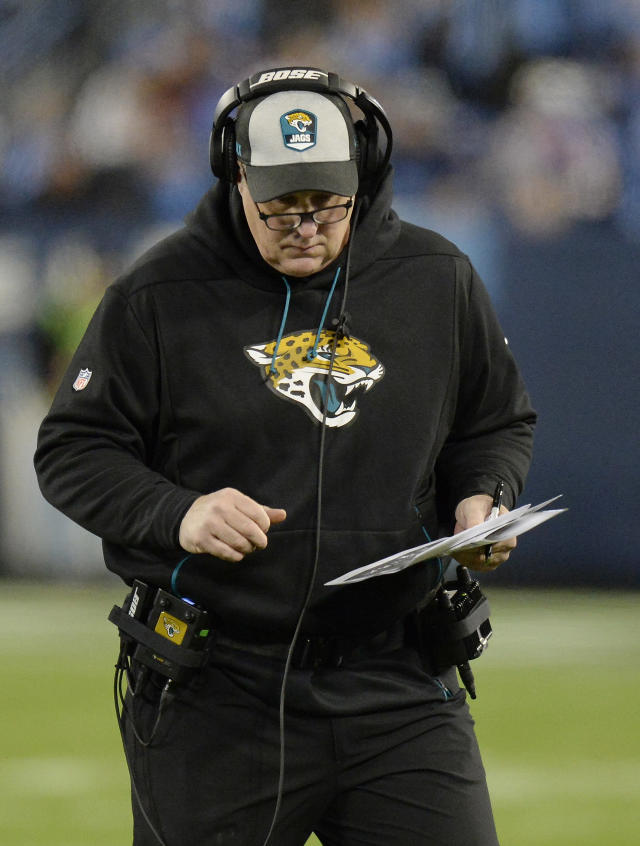 Jacksonville Jaguars head coach Doug Marrone works during the first half of an NFL football game against the Tennessee Titans, Thursday, Dec. 6, 2018, in Nashville, Tenn. (AP Photo/Mark Zaleski)
