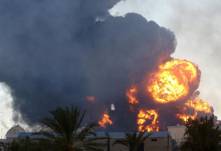 Smoke billows from a petrol depot that has been set ablaze following clashes between rival militias near the airport in the Libyan capital Tripoli on August 2, 2014