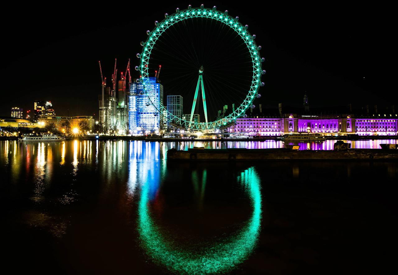 <p>The London Eye is illuminated green by Tourism Ireland to mark St Patrick's Day, which is this Saturday. (PA) </p>