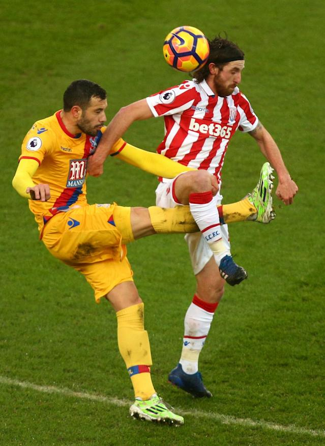 <p>Stoke City's Joe Allen and Crystal Palace's Luka Milivojevic (left) battle for the ball</p>
