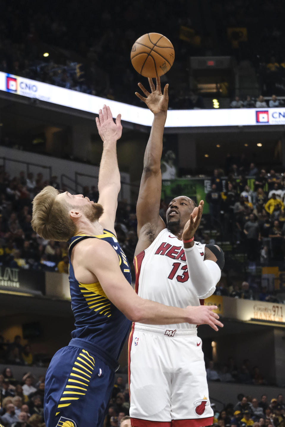 Miami Heat center Bam Adebayo (13) shoots over Indiana Pacers forward Domantas Sabonis (11) during the first half of an NBA basketball game in Indianapolis, Wednesday, Jan. 8, 2020. (AP Photo/AJ Mast)