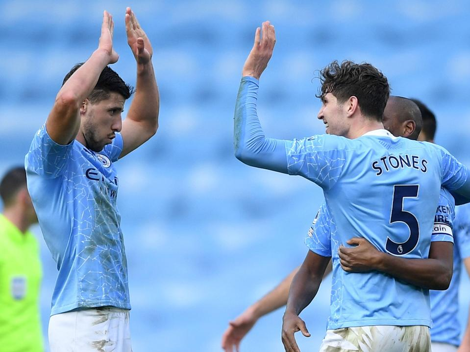 <p>Ruben Dias and John Stones have been immense for Man City this season</p> (Getty)