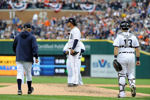 Detroit Tigers starting pitcher Anibal Sanchez stands on the mound as manager Jim Leyland, left, walks up to replace him during the fifth inning of Game 3 of an American League baseball division series against the Oakland Athletics in Detroit, Monday, Oct. 7, 2013. (AP Photo/Lon Horwedel)