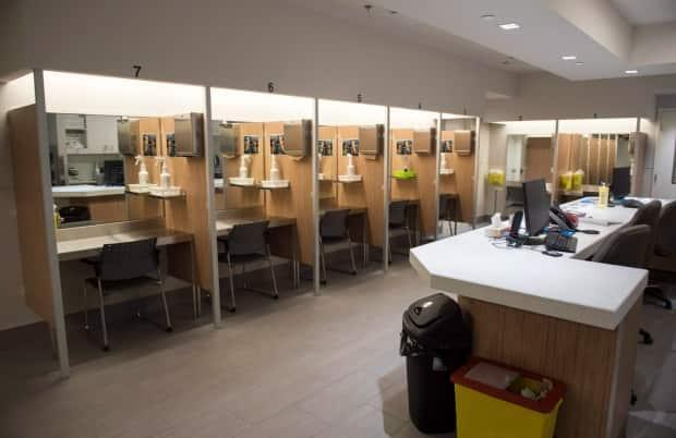 At safe injection sites, like this one in Montreal, staff are there to save intravenous drug users from potentially fatal overdoses. The group behind this legal challenges argues that drug users are staying home due to the curfew, and putting their lives at risk. (Paul Chiasson/The Canadian Press - image credit)
