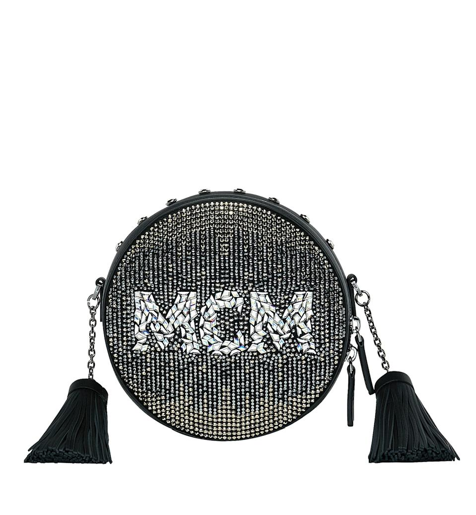 <p><span>Featuring quilted studs and shimmering Swarovski crystals, its sans serif letters on the bag make a statement-making style for fans. Carved from a soft foiled leather base, the bag is easy to carry with ample of space for your party needs.</span> </p>