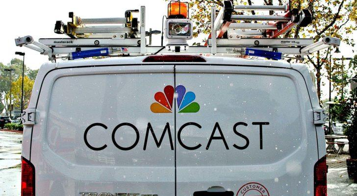 Image of the Comcast (CMCSA) logo on the back of a white van in a rural area
