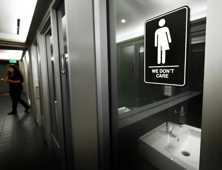 Gender-neutral signs are posted in public restrooms in a hotel in Durham, North Carolina in May 2016 (AFP Photo/SARA D. DAVIS)