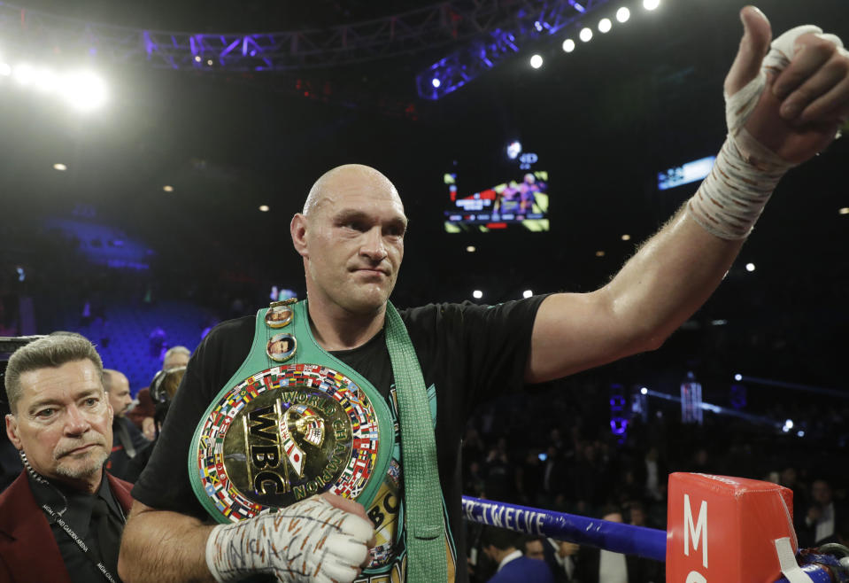 Tyson Fury, of England, celebrates after defeating Deontay Wilder during a WBC heavyweight championship boxing match Saturday, Feb. 22, 2020, in Las Vegas. (AP Photo/Isaac Brekken)