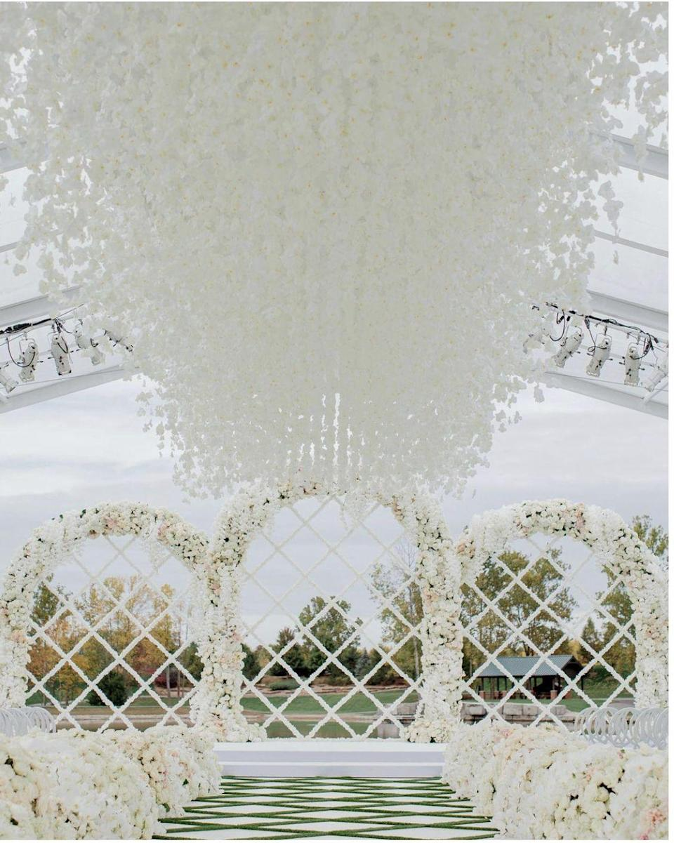 """<p>Rather than focus attention only on the arch, the path, or the view—surprise and delight guests from all angles. An overhead installation makes even a vast, outdoor space feel that much more intimate, and frames the couple as they recite their vows, as well as the setting. </p><p>Rather than just dangling blooms, give some thought to the shape, scale, and movement of what's soaring overhead. Here, strings of orchids double as fluttering butterflies when they're presented in the sky—but floating marigolds or carnations could offer a different yet equally dreamy effect. Trust us: this look is over-the-top yet effortless—in all the right ways. </p><p>Pictured: Planning by <a href=""""https://michelleragodestinations.com/"""" rel=""""nofollow noopener"""" target=""""_blank"""" data-ylk=""""slk:Michelle Rago Destinations"""" class=""""link rapid-noclick-resp"""">Michelle Rago Destinations</a>, Design by Rishi Patel of <a href=""""https://hmrdesigns.com/"""" rel=""""nofollow noopener"""" target=""""_blank"""" data-ylk=""""slk:HMR Designs"""" class=""""link rapid-noclick-resp"""">HMR Designs</a>.</p>"""
