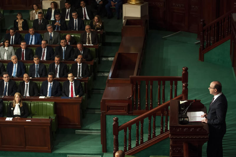Tunisian designated Prime Minister Elyes Fakhfakh, right, delivers his speech at the parliament, Wednesday, Feb. 26, 2020. Tunisia's parliament is expected to hold a confidence vote Wednesday on designated prime minister Elyes Fakhfakh's government. (AP Photo/Hassene Dridi)