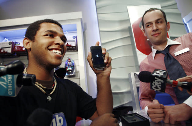 Jordon Brown, the first buyer of the new Apple iPhone 3G in Toronto, shows off his phone July 11, 2008.