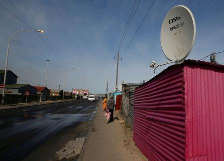 FILE PHOTO: A satellite dish connecting residents to South Africa's DSTV television network, owned by telecommunications giant Naspers in Khayelitsha township
