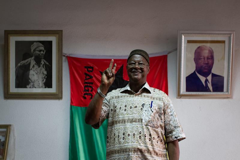 FILE- In this March 21, 2012 file photo, ruling party presidential candidate and Prime Minister Carlos Gomes Junior gestures after the electoral commission announced provisional election results giving him the lead in the first round of presidential voting, in Bissau, Guinea-Bissau. Mortars blasted through the capital of the small, coup-prone nation of Guinea-Bissau on Thursday, April 12, 2012 as the military sealed off the city's downtown area and lobbed grenades at the prime minister's home, according to a diplomat and witnesses. The violence comes just weeks before the country's presidential runoff vote, which Gomes was favored to win. (AP Photo/Tanya Bindra, File)
