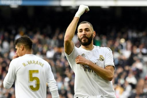 Knockout punch: Karim Benzema celebrated scoring the game-winning goal as Real beat Atletico
