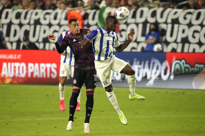 Honduras defenseman Maynor Figueroa (30 and Mexico forward Rogelio Funes Mori vie for the ball during the second half of a CONCACAF Gold Cup soccer match Saturday, July 24, 2021, in Glendale, Ariz. (AP Photo/Rick Scuteri)