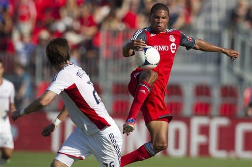 Toronto FC 's Ryan Johnson tries to control the ball against the New England Revolution during first half MLS soccer action in Toronto on Saturday June 23, 2012. (AP Photo/The Canadian Press, Chris Young)