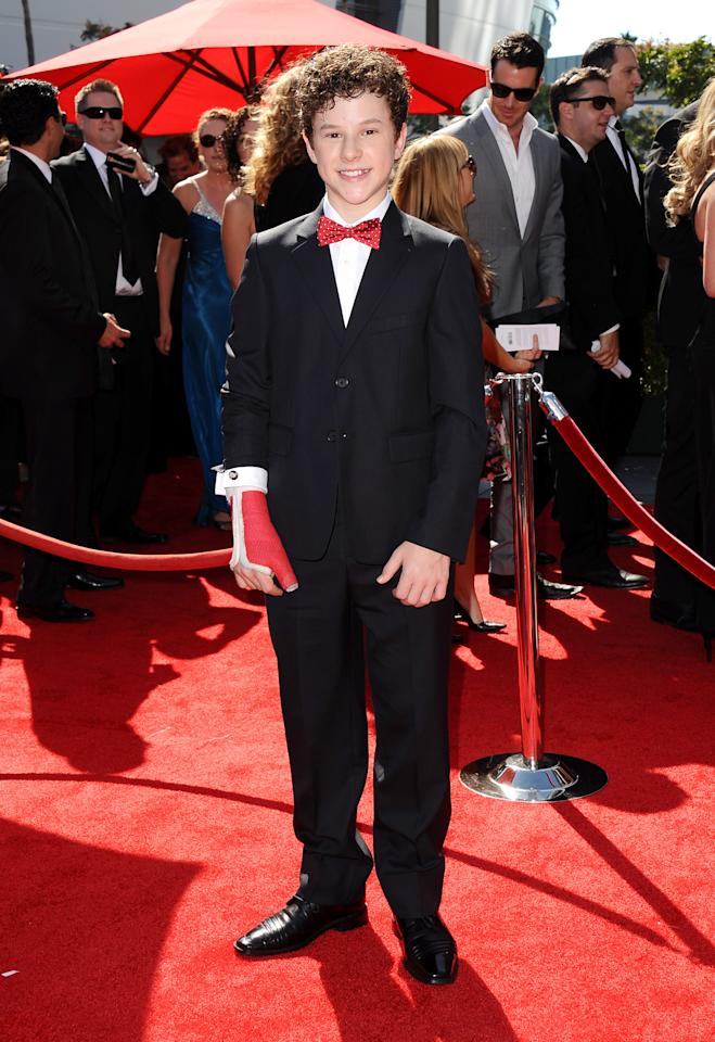Nolan Gould arrives at the 2013 Primetime Creative Arts Emmy Awards, on Sunday, September 15, 2013 at Nokia Theatre L.A. Live, in Los Angeles, Calif. (Photo by Scott Kirkland/Invision for Academy of Television Arts & Sciences/AP Images)