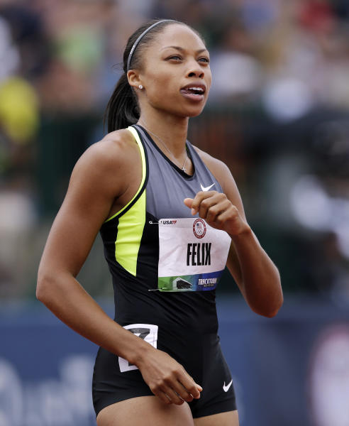 Allyson Felix finishes her heat in the women's 200 meter semi-finals at at the U.S. Olympic Track and Field Trials Friday, June 29, 2012, in Eugene, Ore. (AP Photo/Marcio Jose Sanchez)