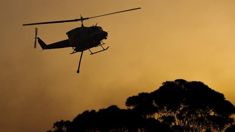 Hot, windy conditions are wreaking havoc as bushfires burn out of control across parts of NSW