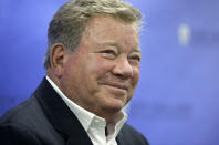 FILE - In this May 6, 2018 file photo, actor William Shatner takes questions from reporters after delivering the commencement address at New England Institute of Technology graduation ceremonies, in Providence, R.I. Star Trek's Captain Kirk is rocketing into space this month — boldly going where no other sci-fi actors have gone. Jeff Bezos' space travel company, Blue Origin, announced Monday, Oct. 4, 2021 that Shatner will blast off from West Texas on Oct. 12. (AP Photo/Steven Senne, file)