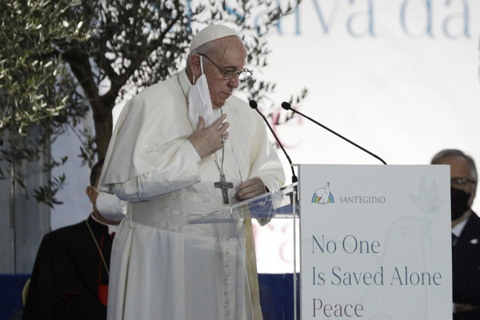 Pope Francis speaks during an inter-religious ceremony for peace in the square outside Rome's City Hall, Tuesday, Oct. 20, 2020 (AP Photo/Gregorio Borgia)