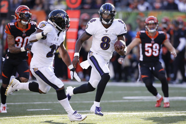 Baltimore Ravens quarterback Lamar Jackson (8) runs the ball for a touchdown during the second half of NFL football game against the Cincinnati Bengals, Sunday, Nov. 10, 2019, in Cincinnati. (AP Photo/Gary Landers)