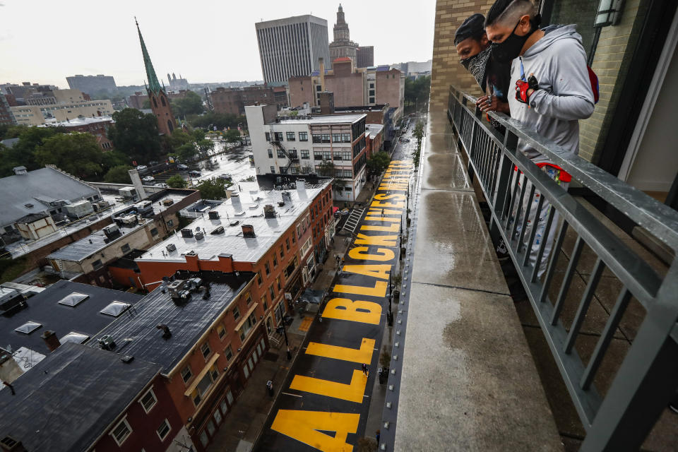 "FILE - In this June 27, 2020, file photo, a mural that reads ""ALL BLACK LIVES MATTER"" is painted on Halsey Street in Newark, N.J. Thousands of Black activists from across the U.S. will hold the 2020 Black National Convention on Aug. 28, 2020, via livestream to produce a new political agenda that builds on the protests that followed George Floyd's death. Organizers of the gathering shared their plans with The Associated Press on Wednesday, July 1, ahead of an official announcement. (AP Photo/John Minchillo, File)"