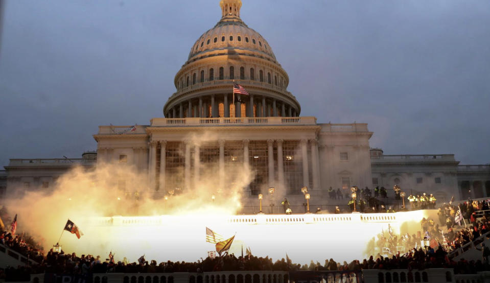 An explosion caused by a police munition is seen while supporters of U.S. President Donald Trump gather in front of the U.S. Capitol Building during the riots. Source: Reuters/Leah Millis