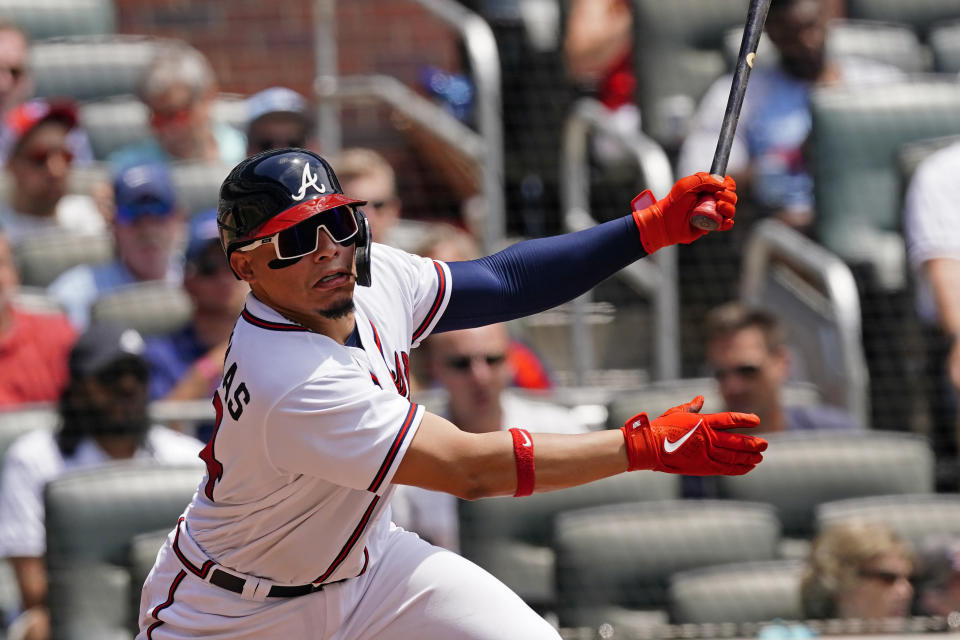 Atlanta Braves catcher William Contreras (24) follows through on a base hit in the second inning of a baseball game against the Washington Nationals Thursday, June 3, 2021, in Atlanta. (AP Photo/John Bazemore)