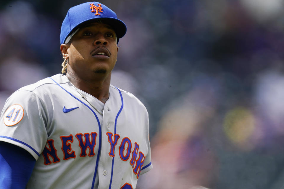 New York Mets starting pitcher Marcus Stroman pauses between pitches in the sixth inning of a baseball game Sunday, April 18, 2021, in Denver. (AP Photo/David Zalubowski)