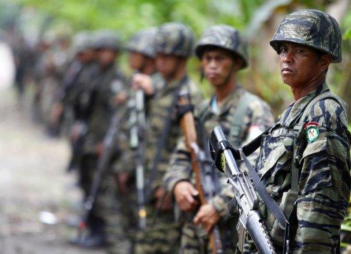 Moro Islamic Liberation Front (MILF) rebels stand guard