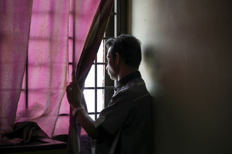 Rohingya refugee and activist Zafar Ahmad Abdul Ghani looks out from his home in Kuala Lumpur