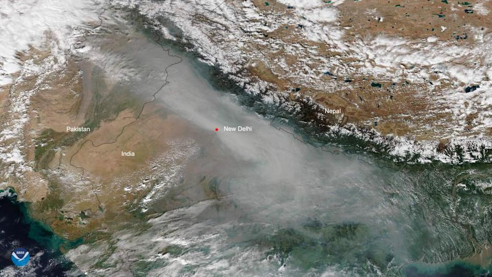 A satellite image taken on 31 October showing smog lingering over New Delhi