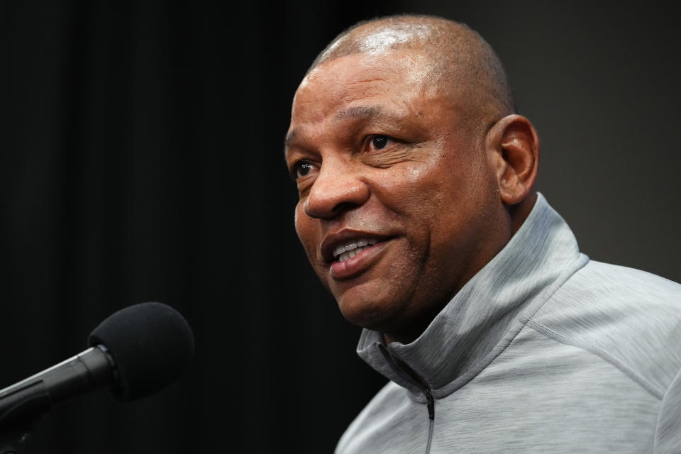 Philadelphia 76ers head coach Doc Rivers speaks to the media before a preseason NBA basketball game against the Brooklyn Nets, Monday, Oct. 11, 2021, in Philadelphia. Rivers says the franchise still wants disgruntled All-Star guard Ben Simmons to the return to the team. (AP Photo/Matt Slocum)