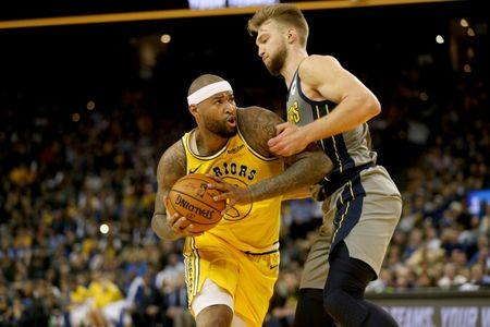 Mar 21, 2019; Oakland, CA, USA; Golden State Warriors center DeMarcus Cousins (0) attempts to drive past Indiana Pacers forward Domantas Sabonis (11) in the fourth quarter at Oracle Arena. Mandatory Credit: Cary Edmondson-USA TODAY Sports