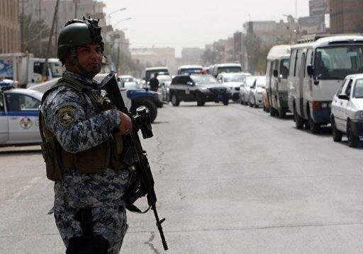 Iraqi security forces set up checkpoints on streets leading to the heavily fortified Green Zone in Baghdad on March 27