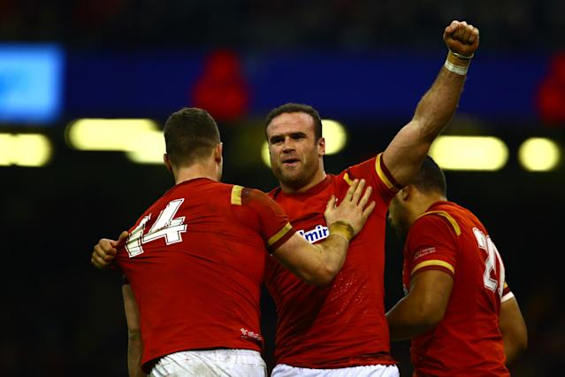 Wales' Jamie Roberts (C) celebrates with teammates after scoring their third try during the Six Nations international rugby union match between Wales and Ireland at the Principality Stadium in Cardiff, south Wales, on March 10, 2017.Wales won the game 22-9. (AFP Photo/Geoff CADDICK)