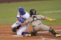 Los Angeles Dodgers' Chris Taylor, left, collides with San Diego Padres catcher Austin Hedges as he is tagged out while trying to score on a double by Kik Hernndez during the second inning of a baseball game Tuesday, Aug. 11, 2020, in Los Angeles. (AP Photo/Mark J. Terrill)
