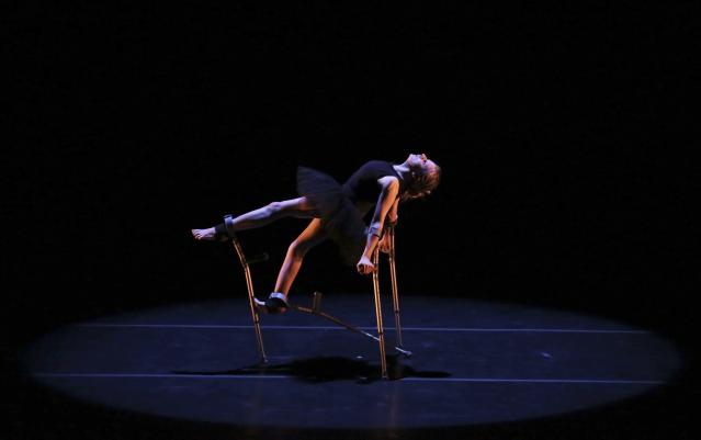 """Scottish dancer Claire Cunningham, who was born with osteoporosis, performs with crutches a piece called """"Mobile-Evolution"""" at Sergio Cardoso Theatre in Sao Paulo October 26, 2013. According to local media, Cunningham states how using crutches gave her the physical abilities to create a career in dance. REUTERS/Nacho Doce (BRAZIL - Tags: SOCIETY TPX IMAGES OF THE DAY)"""