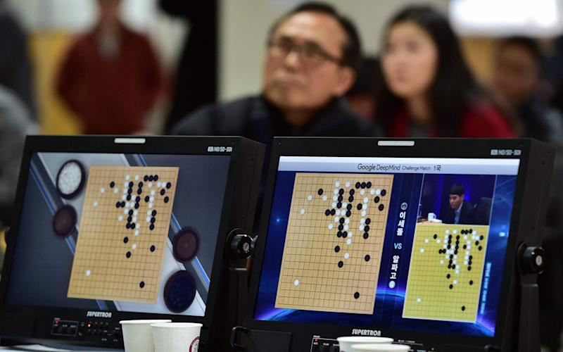 A Go match in play - AFP