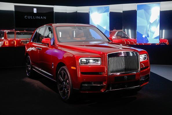 A Rolls-Royce Cullinan sport utility vehicle (SUV) stands on display during its media launch at Rolls-Royce Motor Cars Ltd. headquarters in Chichester, U.K. Named after the largest diamond discovered to date, the $325,000 vehicle is the latest in a long line of six-figure big rigs from the world's most prestigious automakers. Photographer: Luke MacGregor/Bloomberg