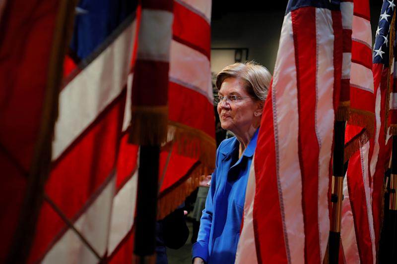 Democratic 2020 U.S. presidential candidate and U.S. Senator Elizabeth Warren (D-MA) greets audience members after delivering a campaign economic speech at Saint Anselm College's Institue of Politics in Manchester, New Hampshire, U.S., December 12, 2019. REUTERS/Brian Snyder