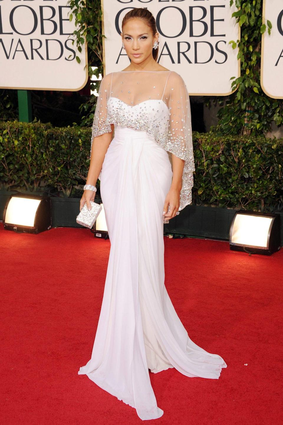 <p>The diva went demure: Jennifer Lope presented in an angelic caped Zuhair Murad gown.</p>