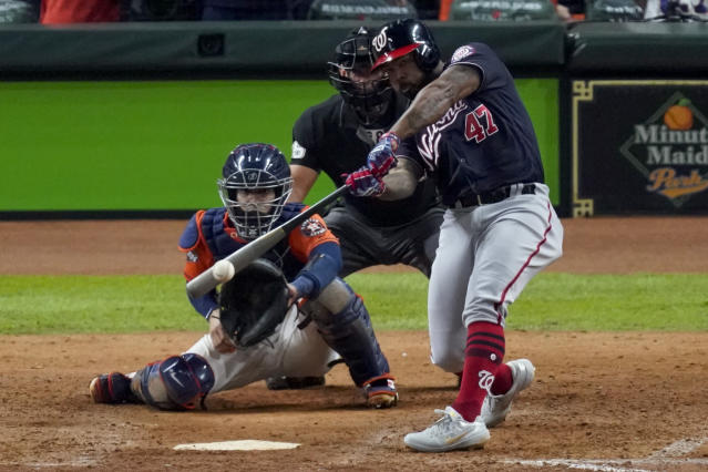 FILE - In this Oct. 30, 2019, file photo, Washington Nationals' Howie Kendrick hits a two-run home run against the Houston Astros during the seventh inning of Game 7 of the baseball World Series in Houston. To many National League fans, the scribble of DH on the lineup card sullies the whole stadium. To lots of American League fans, the sight of a pitcher touching a Louisville Slugger is a total affront to the diamond. No matter, thats part of the proposal MLB owners are making to the players -- a full-time DH in the National League. This year only. (AP Photo/Eric Gay, File)