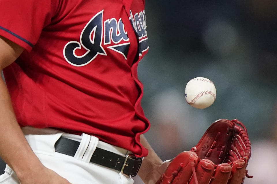 Cleveland Indians relief pitcher James Karinchak tosses the ball between pitches during the eighth inning of the team's baseball game against the Baltimore Orioles, Tuesday, June 15, 2021, in Cleveland. (AP Photo/Tony Dejak)