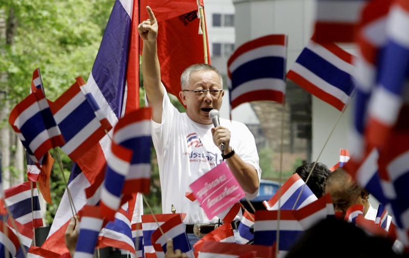 FILE - In this March 27, 2006, file photo, co-leader of anti-Prime Minister Thaksin Shinawatra's demonstrators, Sondhi Limthongkul, addresses the demonstrators after submitting the letter to national police chief at police headquarters in Bangkok, Thailand. Sondhi Limthongkul, a flamboyant media mogul who led an ultimately successful campaign to oust Prime Minister Thaksin Shinawatra from office in 2006, on Wednesday, Sept. 4, 2019, was freed early from a 20-year prison sentence for financial fraud. (AP Photo/Apichart Weerawong, File)