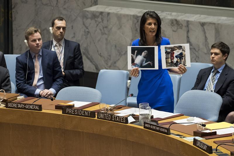 NEW YORK, NY - APRIL 5: U.S. Ambassador to the United Nations Nikki Haley holds up photos of victims of the Syrian chemical attack during a meeting of the United Nations Security Council at U.N. headquarters, April 5, 2017 in New York City. The Security Council is holding emergency talks on Wednesday following the worst use of chemical weapons in Syria since the Ghouta attack in 2013. Drew Angerer/Getty Images/AFP