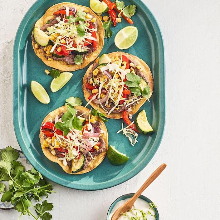 <p>Pile vegetables and black beans onto crisp tostadas and top them off with lime crema for a vegetarian dinner the whole family will love. Charring the vegetables under the broiler infuses them with smoky flavor while cooking them quickly.</p>